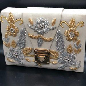 white hand embroidered royal clutch